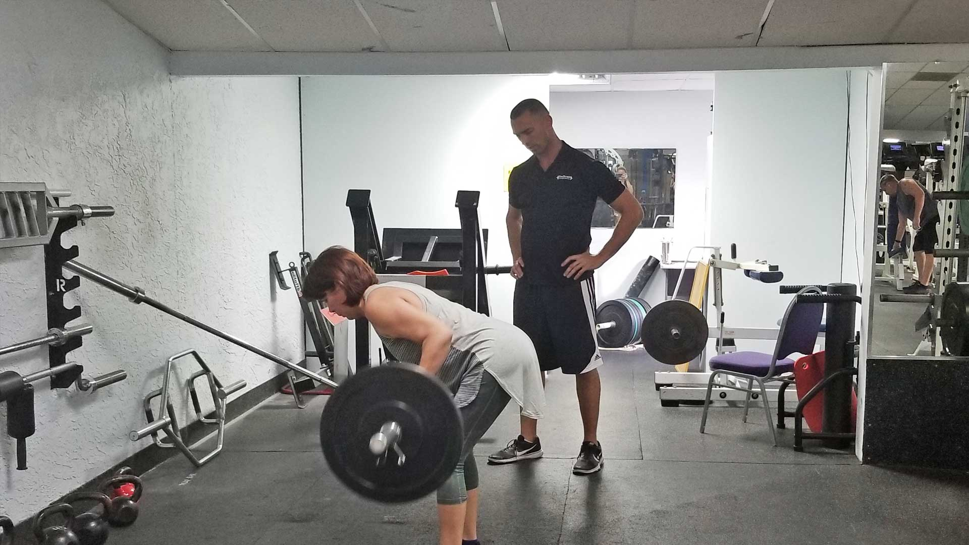 Personal training instruction on how to do a barbell row in Apollo Beach.