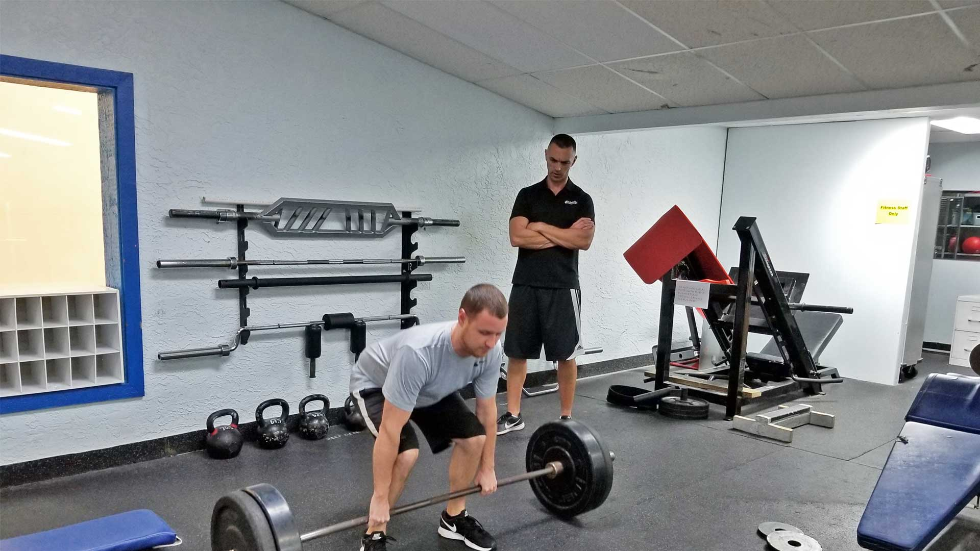 Francois founder of FastTwitch Fitness Performance training a client on how to do a proper dead lift in Apollo Beach