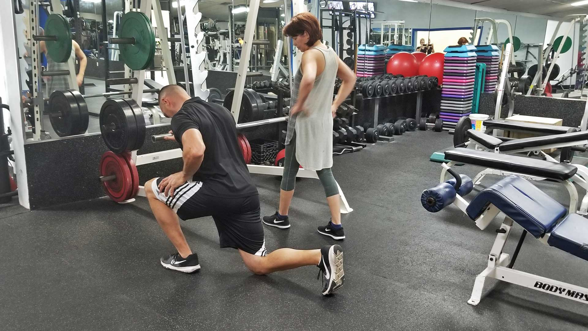 Personal trainer, Francois Tort teaching a client the proper way to do a reverse lunge in Ruskin, FL.