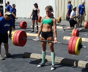 Female during a dead lift at an Apollo Beach gym.
