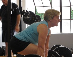 Mature Athlete/ Senior dead lift at an Apollo Beach gym.