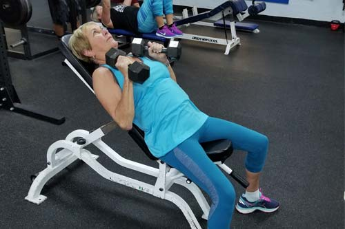 Mature athlete working out at the gym in Apollo Beach, FL.